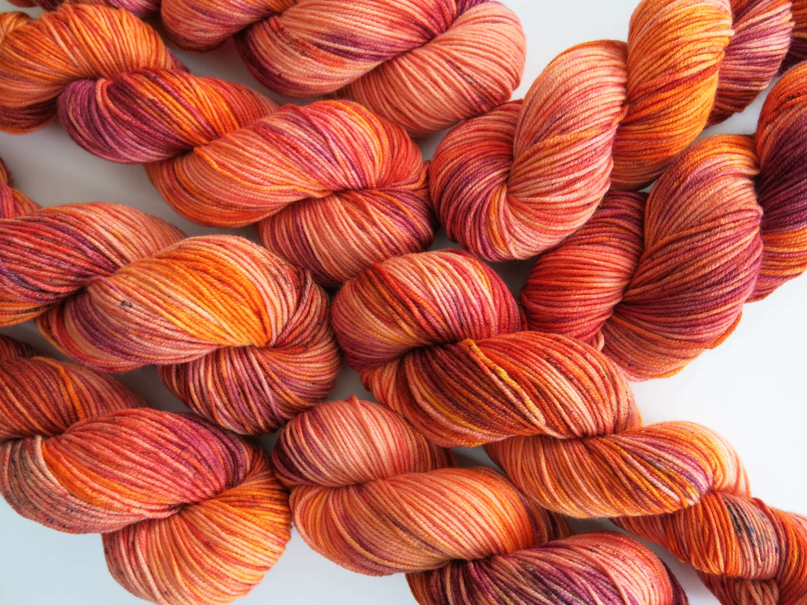 indie dyed orange merino dk yarn skeins