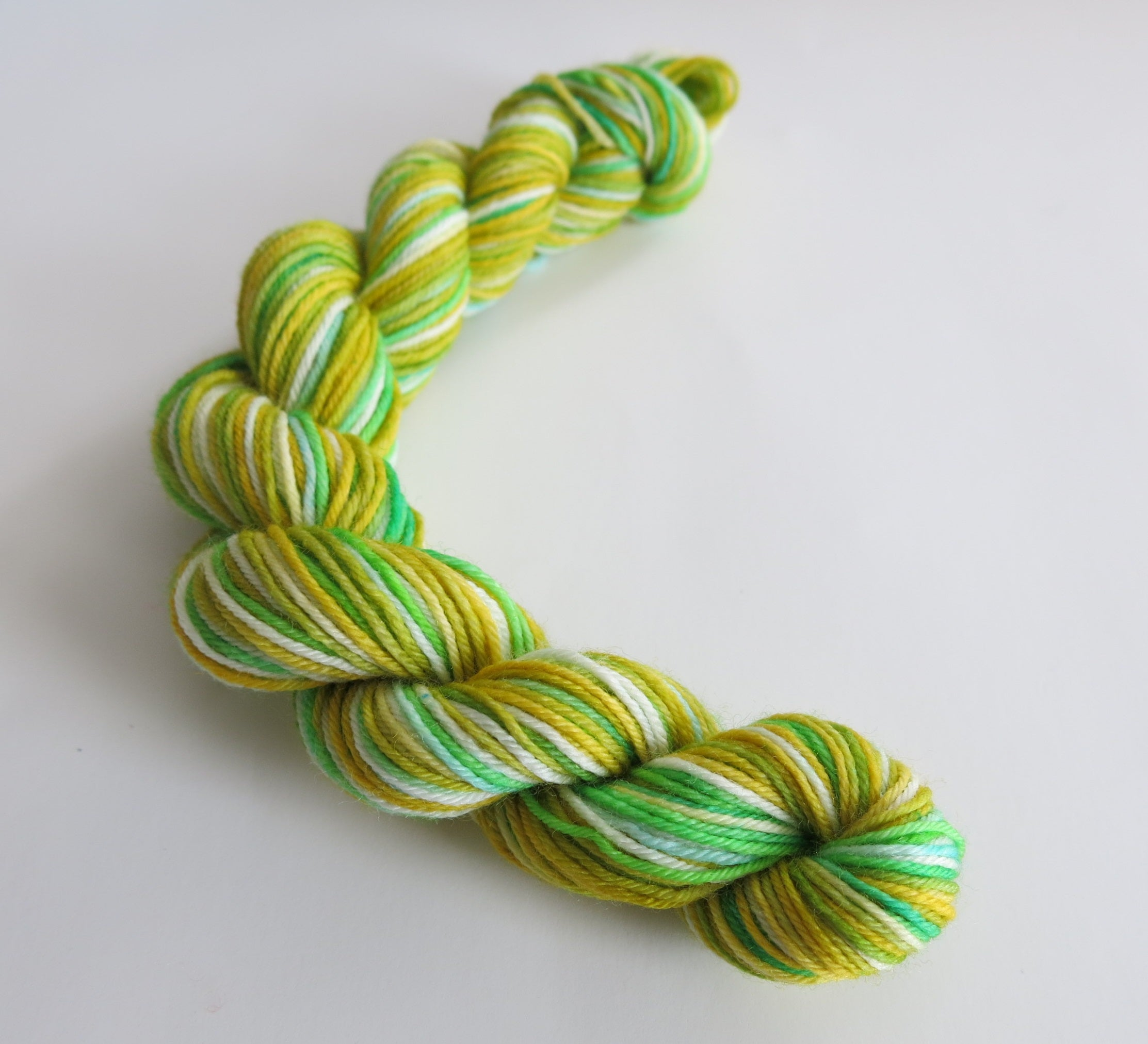 hand dyed green and yellow sock yarn mini skein