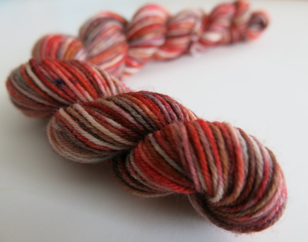 hand dyed red speckled sock yarn mini skein
