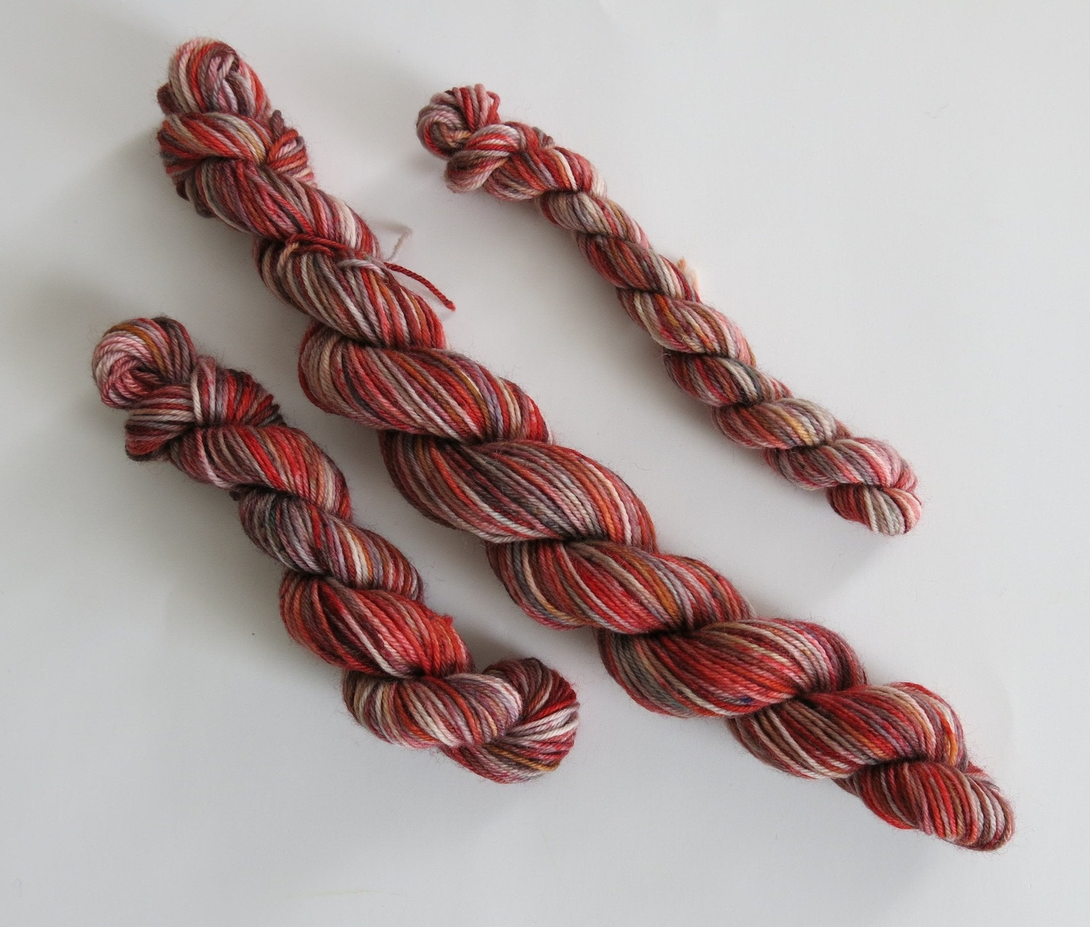 indie dyed red speckled sock yarn mini skein