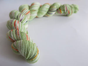 hand dyed green speckled sock yarn mini skein