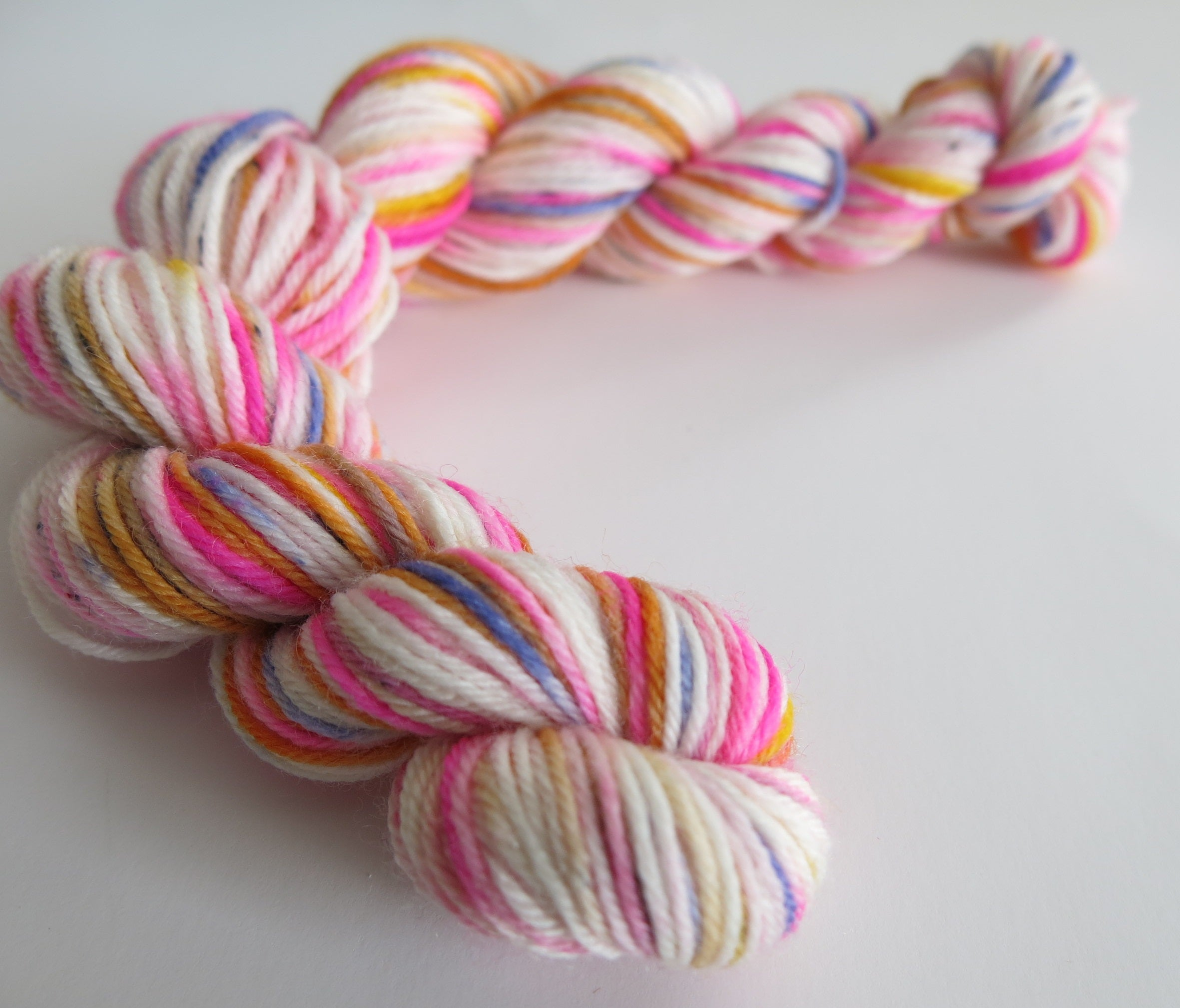 hand dyed pink and orange uv reactive mini skein