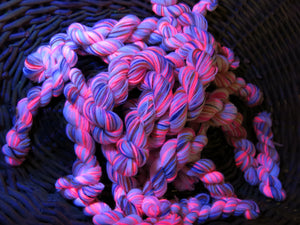hand dyed pink uv reactive sock yarn mini skein under black light