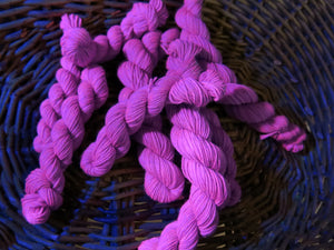 hand dyed purple uv reactive mini skein under black light