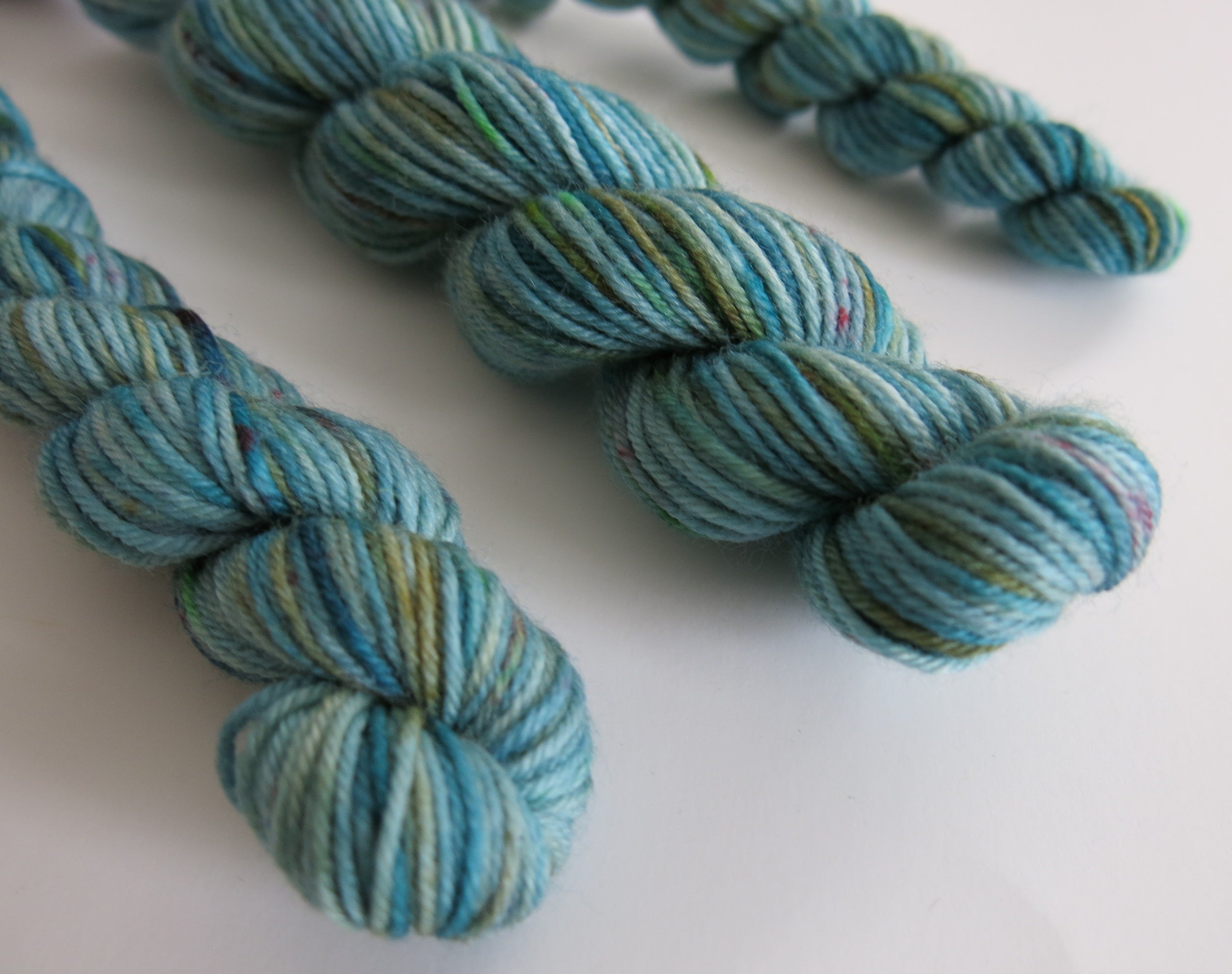 hand dyed blue green superwash merino sock yarn mini skein