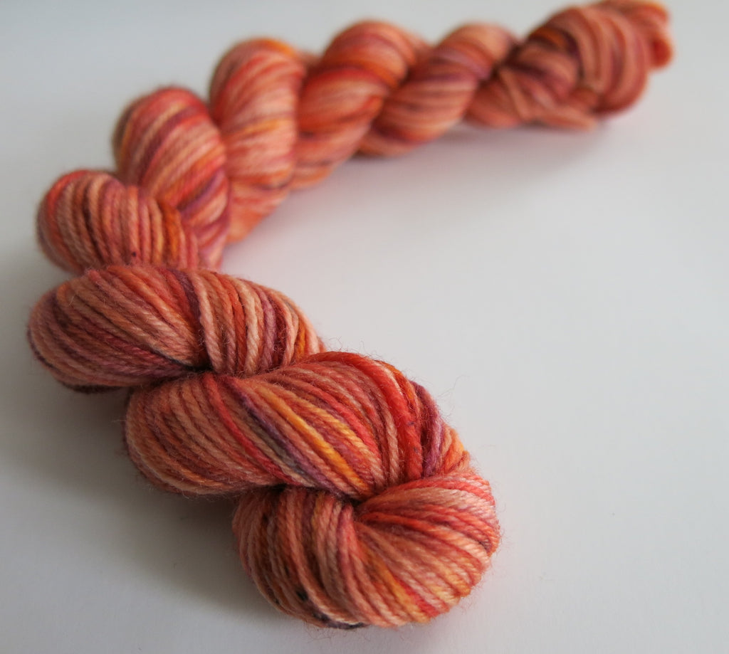 hand dyed orange speckled sock yarn