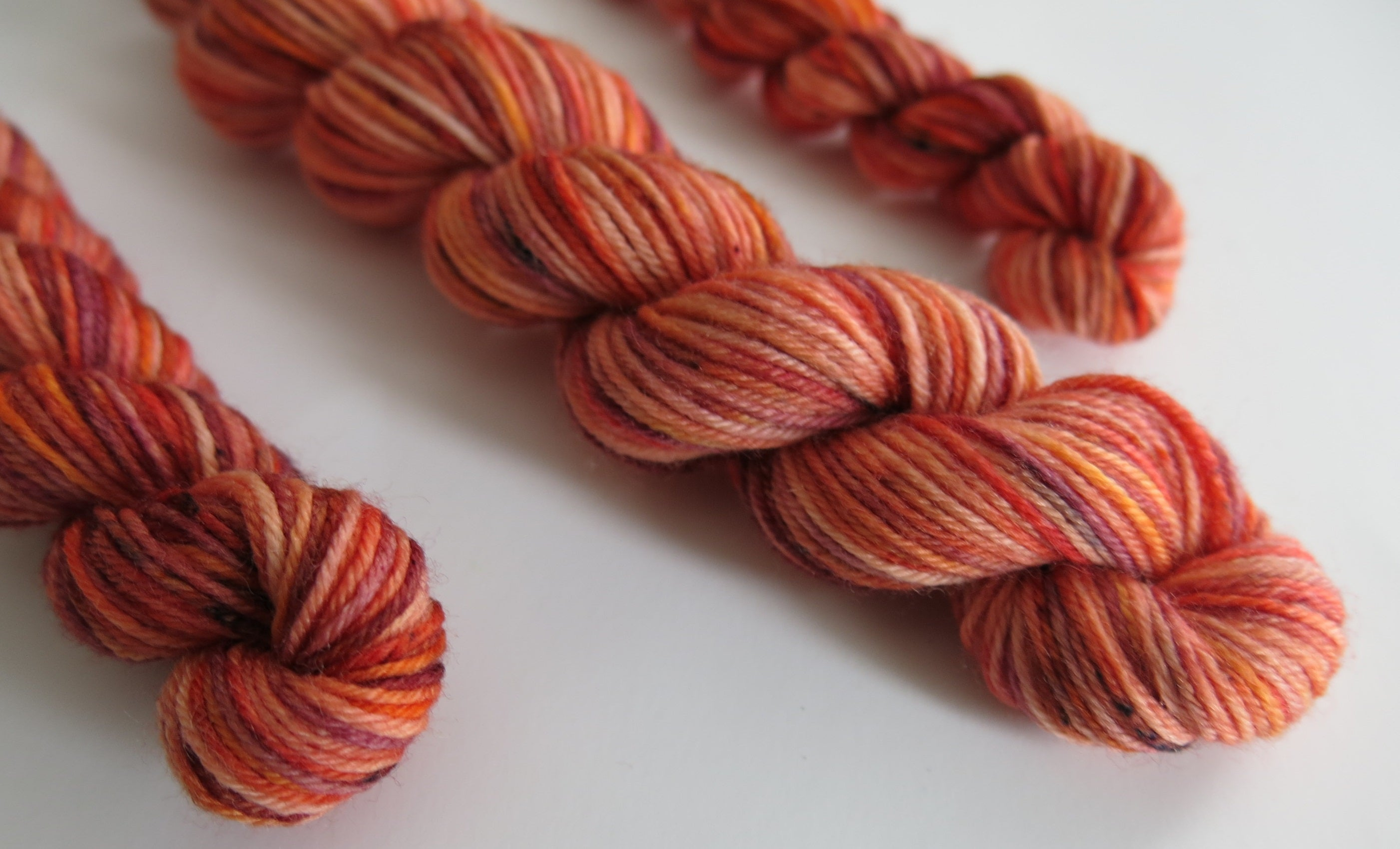 indie dyed uv reactive orange speckled sock yarn