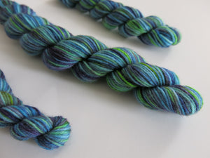 unique hand dyed blue green uv reactive sock yarn