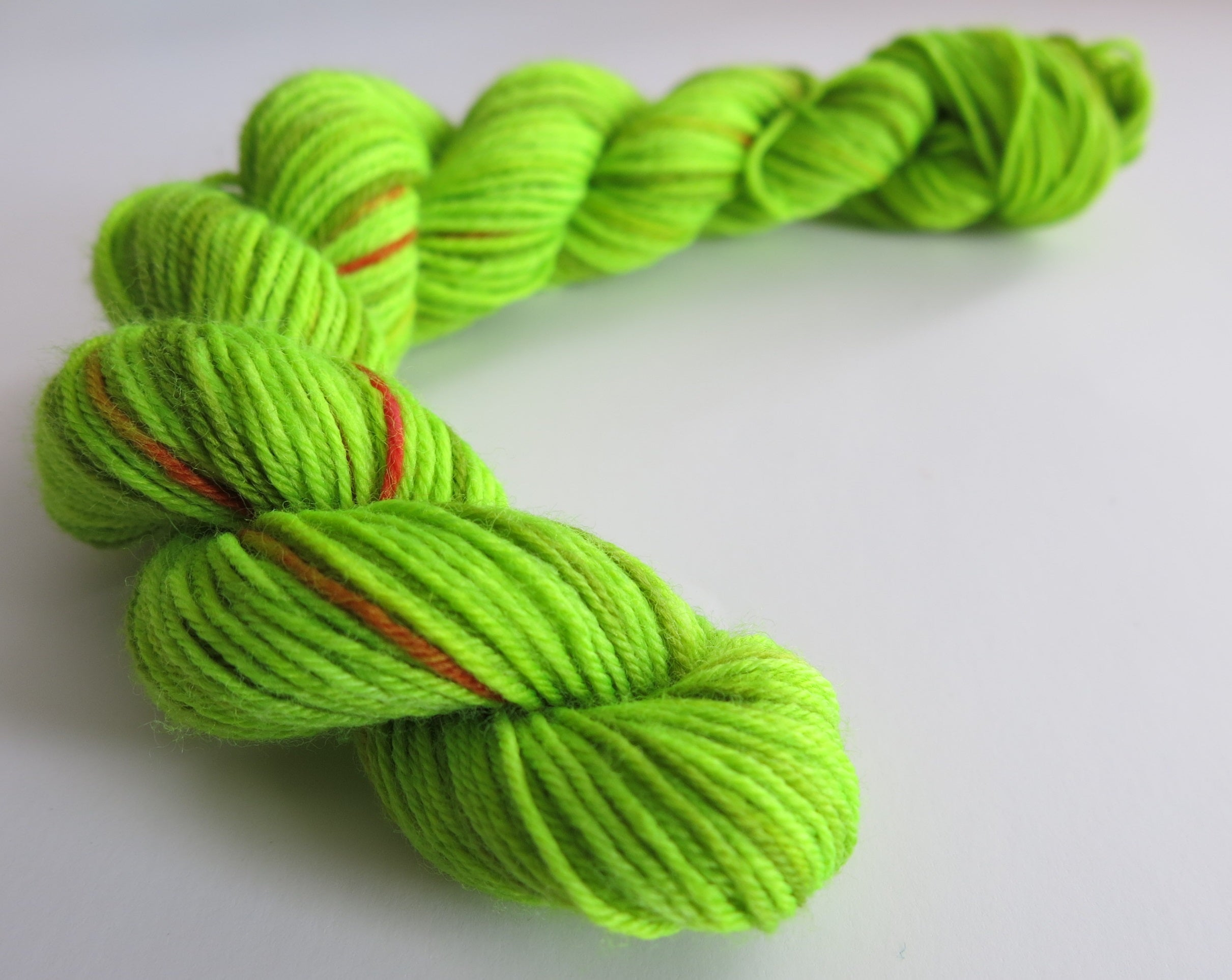 hand dyed uv reactive christmas sock yarn