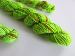 indie dyed uv reactive grinch christmas sock yarn
