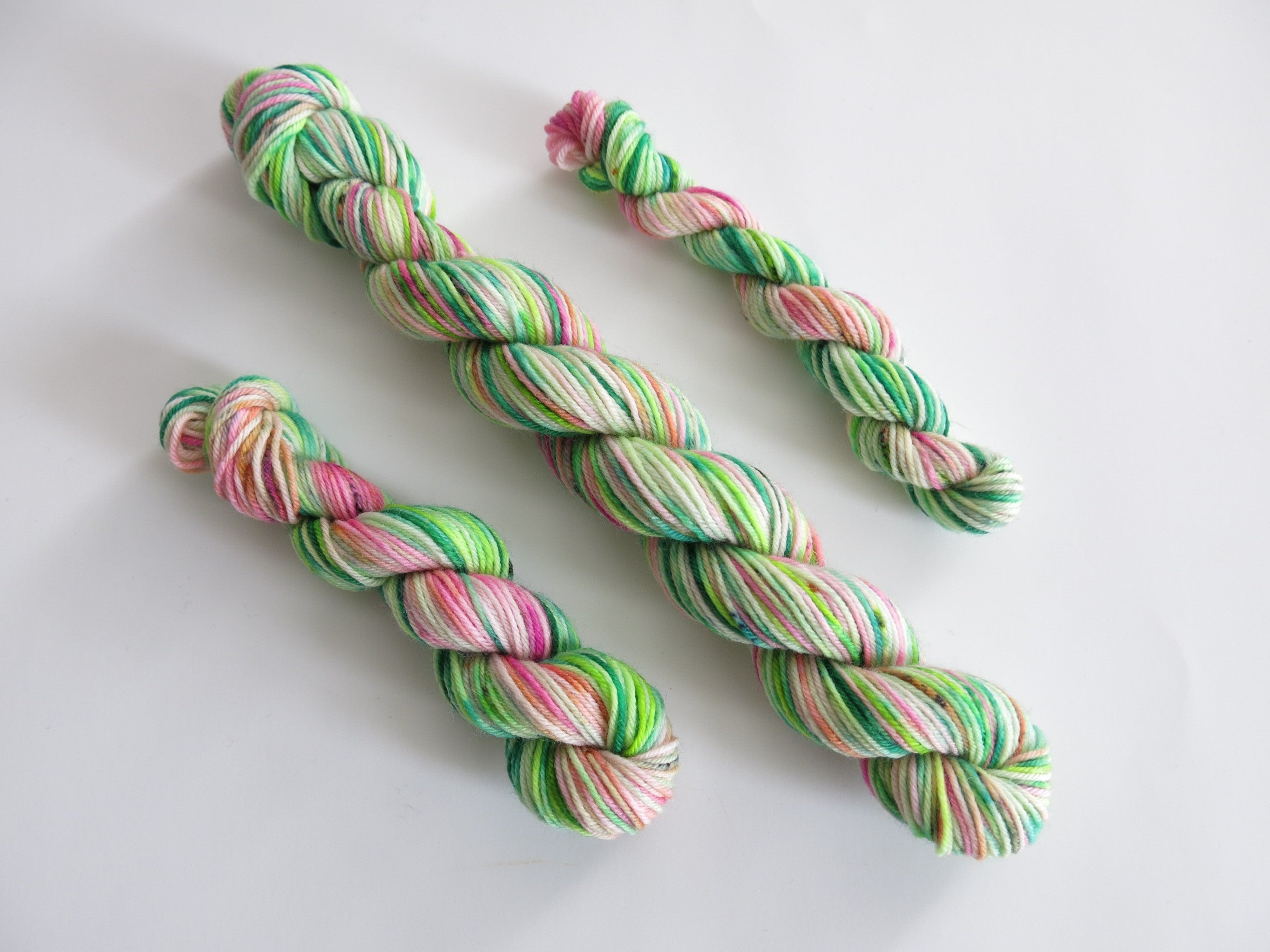 indie dyed uv reactive pink and green sock yarn