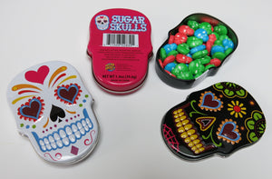 Pink, black and white Day of the Dead sugar skull tins with skull candy