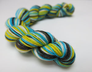 hand dyed alice in wonderland sock yarn