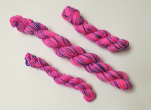 pink and purple alice in wonderland yarn mini skeins