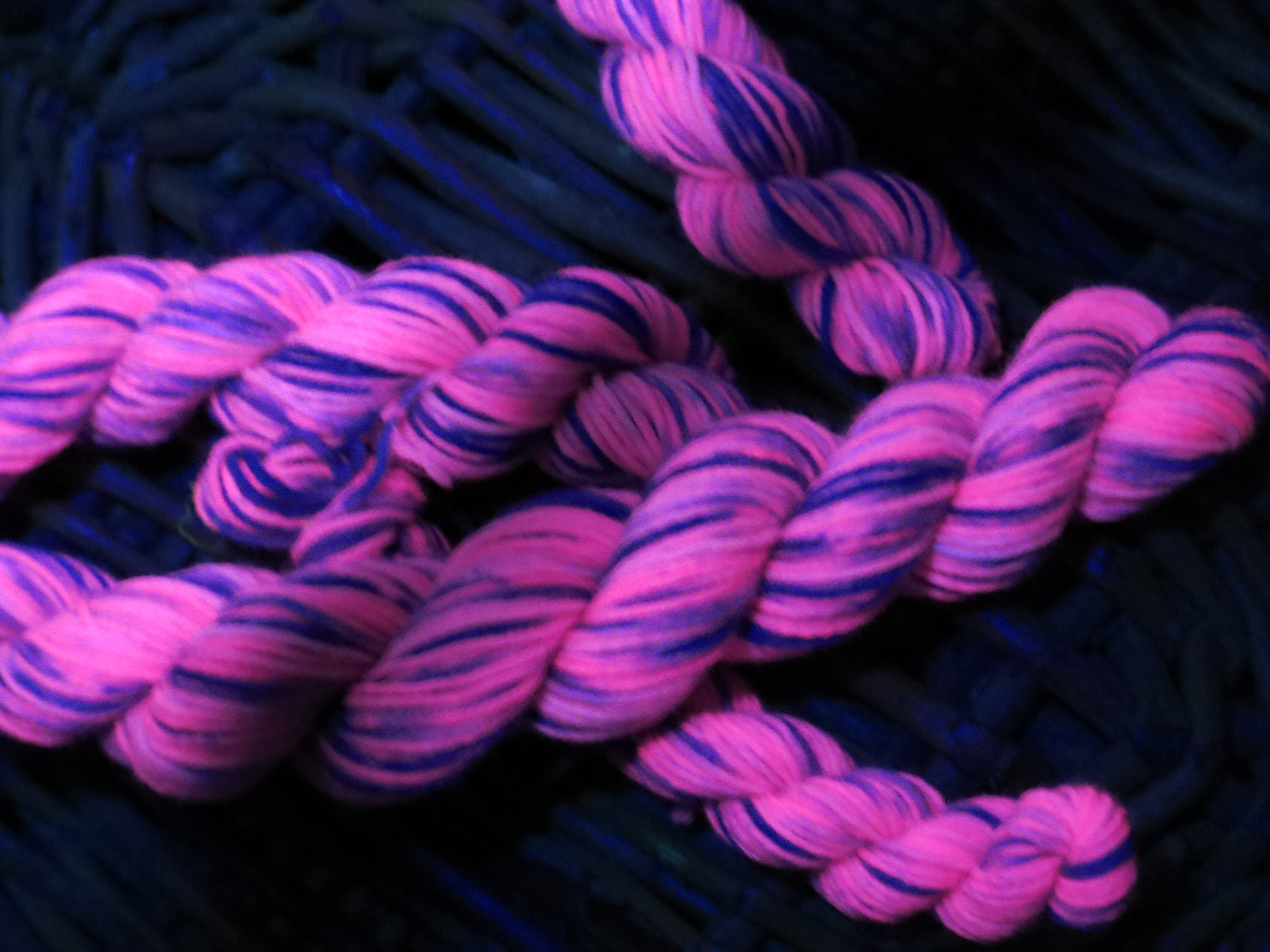 chesire cat hand dyed sock yarn under uv black light