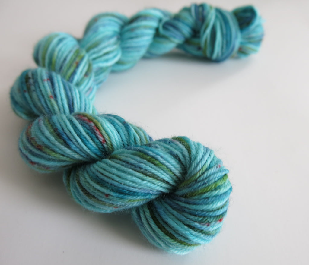 indie dyed blue and green yarn with speckles