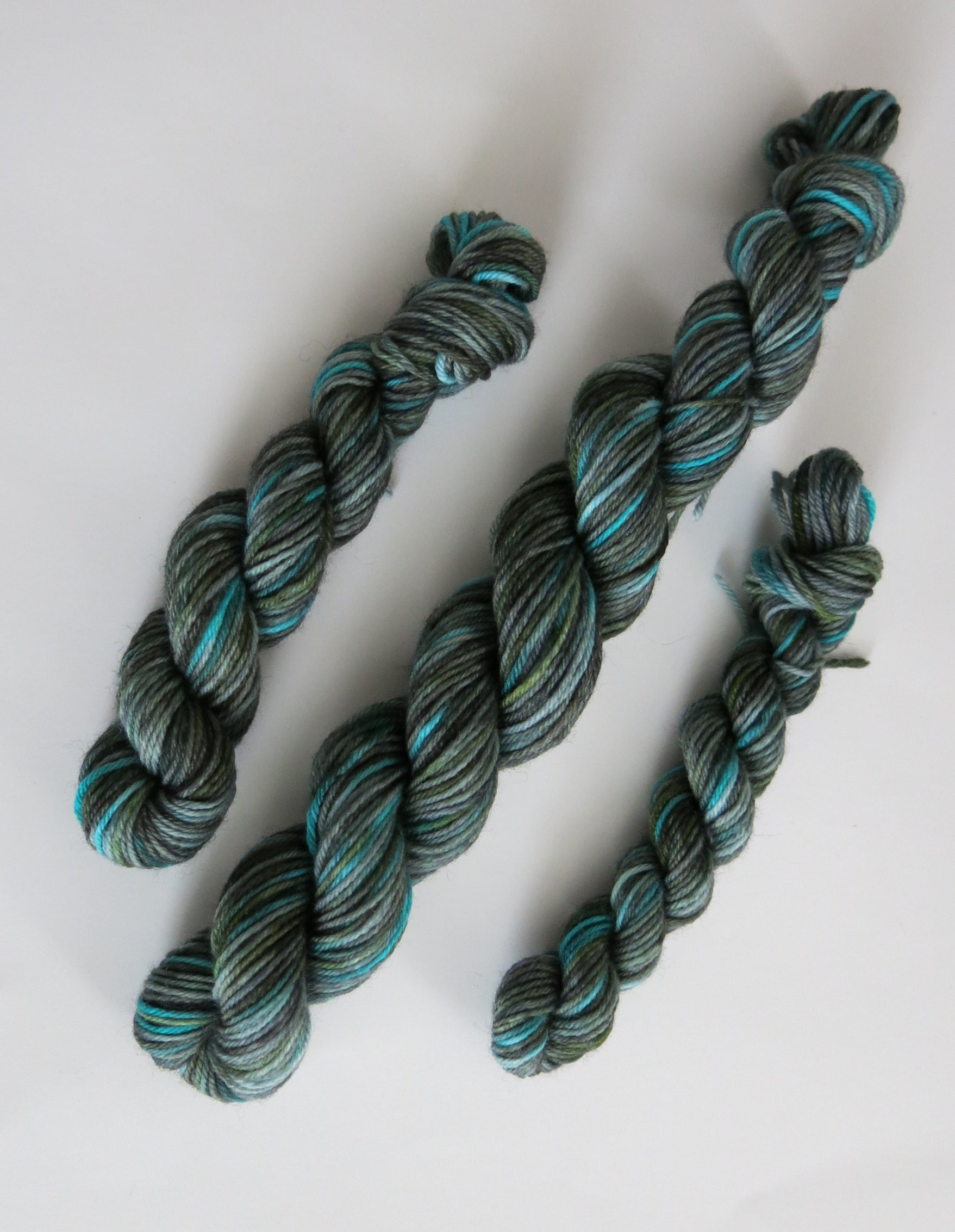 hand dyed yarn mini skeins in grey, blue and green