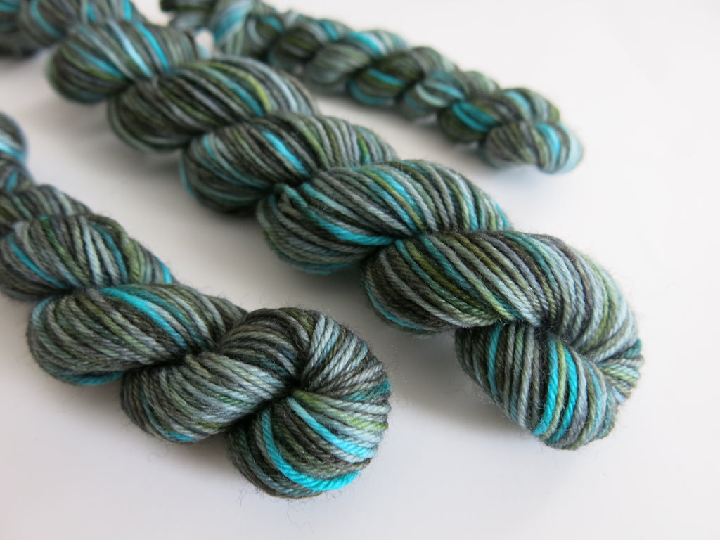 hand dyed blue and green superwash merino sock yarn skeins