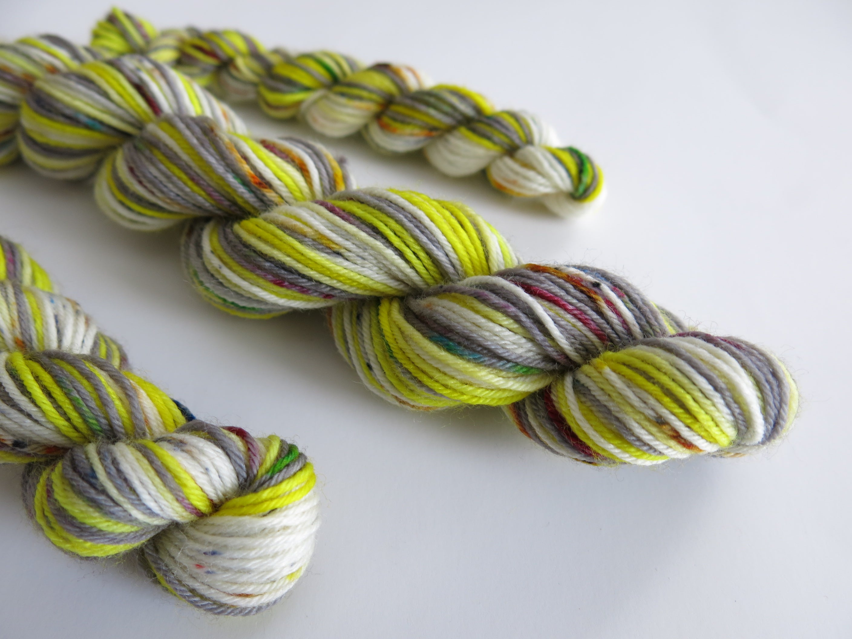 hand dyed speckled superwash sock yarn