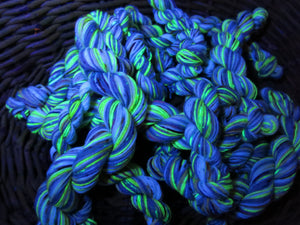 hand dyed uv reactive yellow yarn glowing under black light