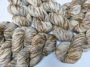 brown speckled hand dyed yarn with a scottish theme