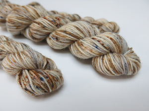 hand dyed speckled yarn in brown and grey