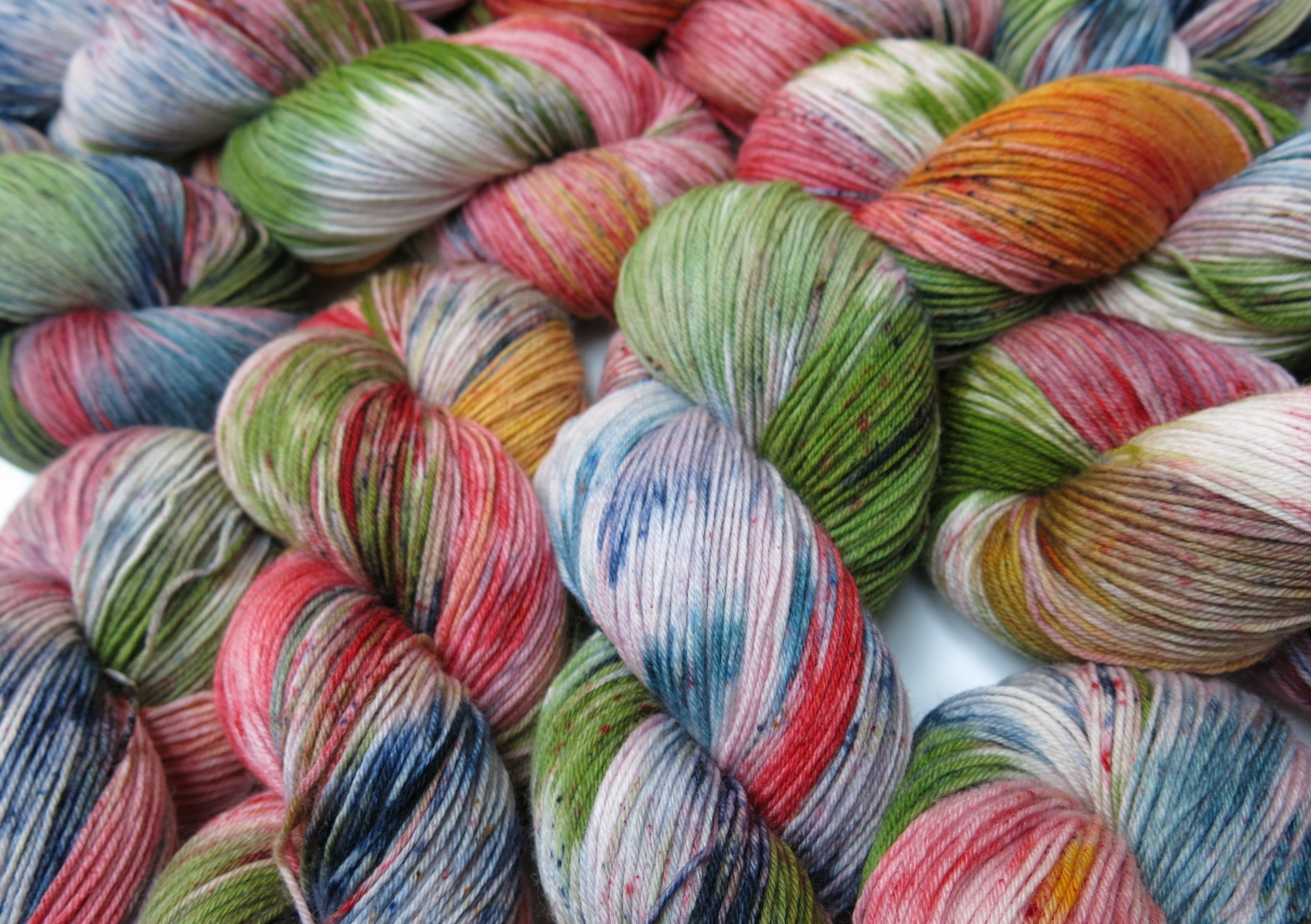 multi coloured speckled merino and nylon yarn skeins