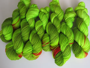 grinch themed hand dyed merino and nylon dk yarn skeins