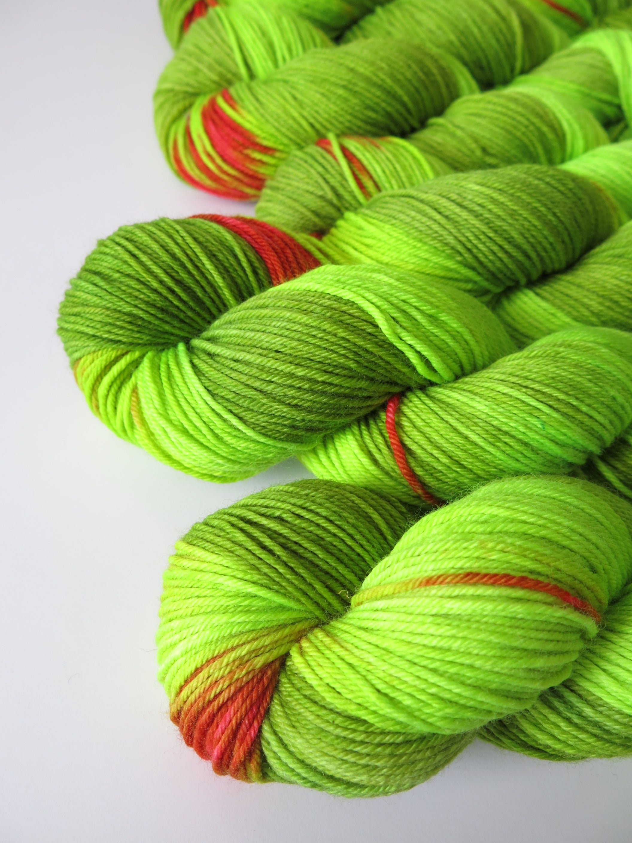 green and red neon christmas grinch yarn