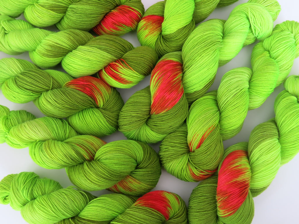 hand dyed neon green grinch christmas sock yarn skeins