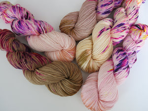 hand dyed variety of dk yarn with speckles in flesh tones