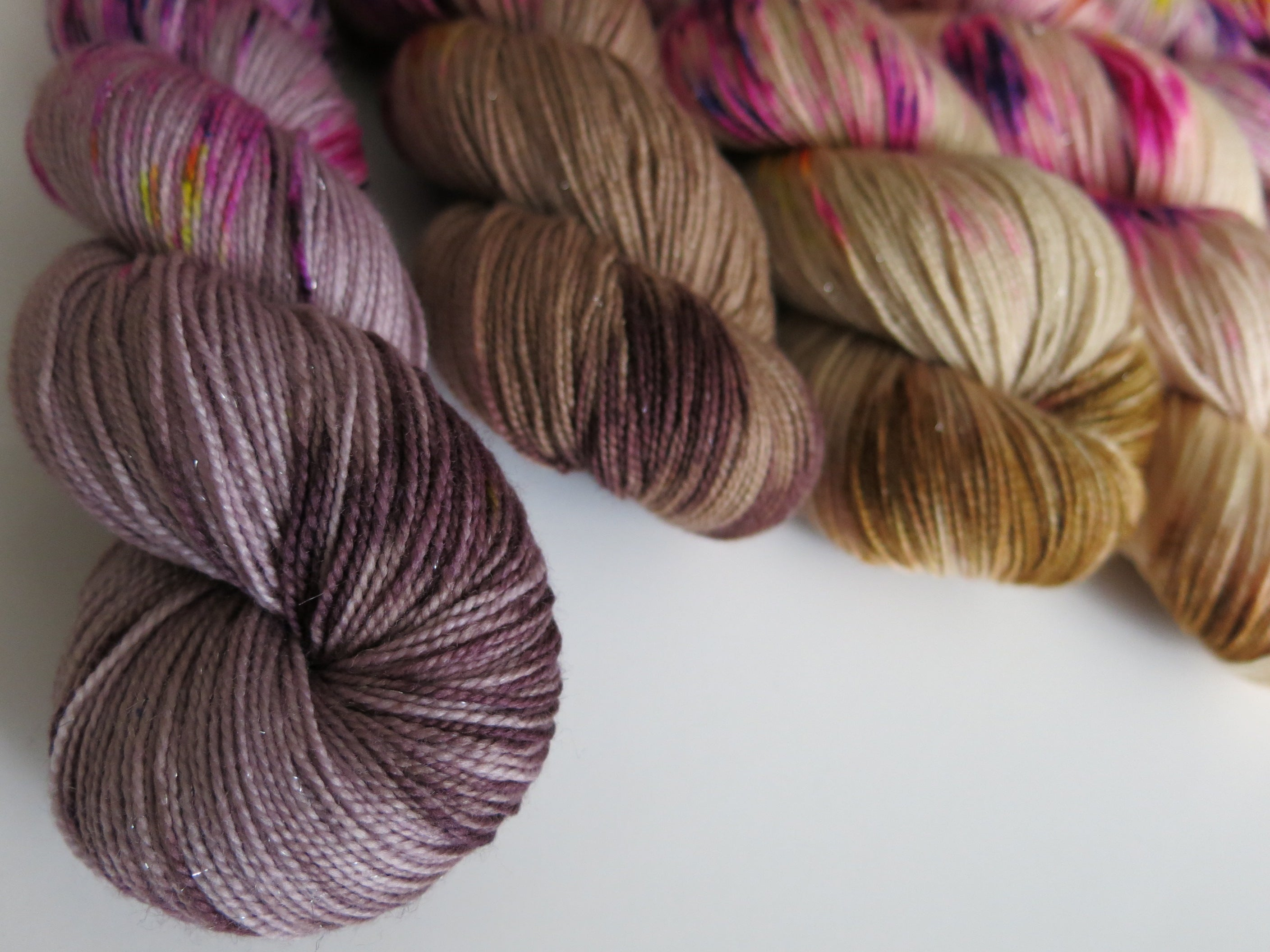 hand dyed sparkly silver merino sock yarn skeins