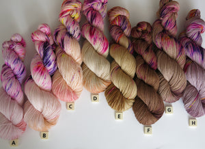selection of milk machines on superwash merino sock yarn