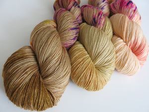 hand dyed flesh toned choufunga sock yarn skeins