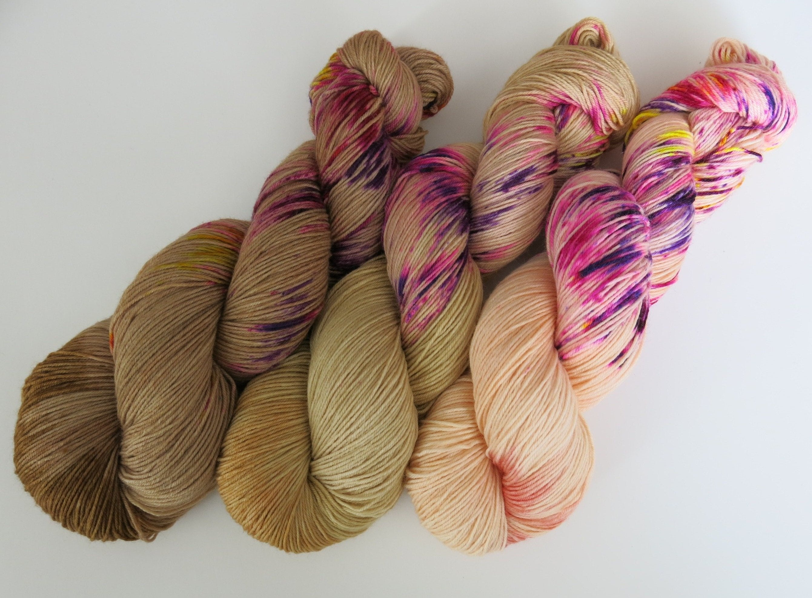 indie dyed speckled and pastel sock yarn skeins