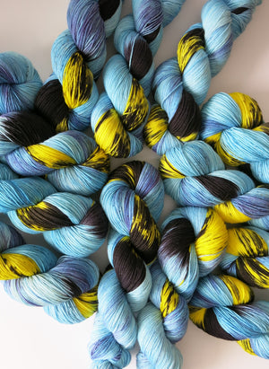 indie dyed blue and yellow superwash merino sock yarn skeins