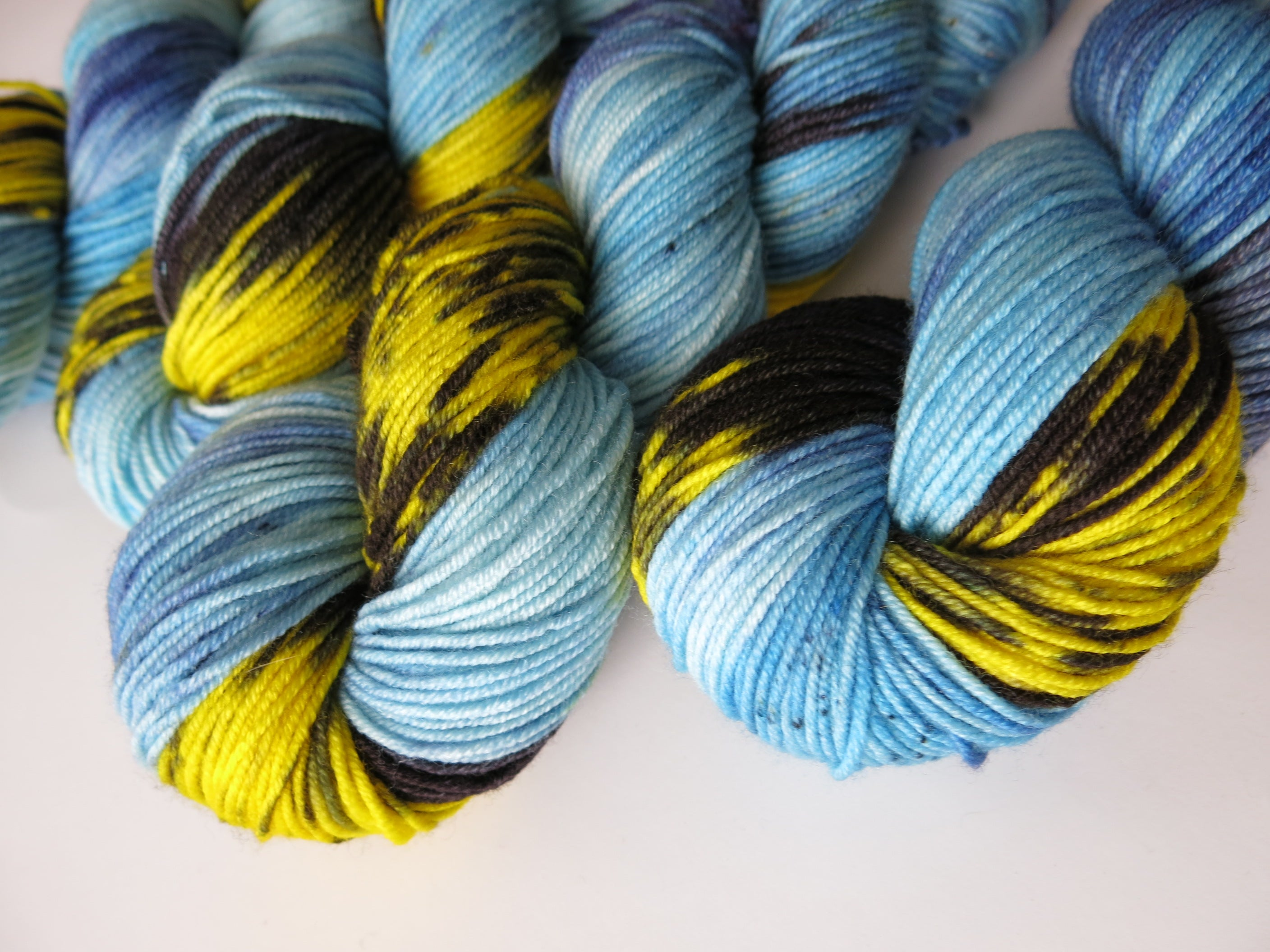 hand dyed 8 ply superwash merino yarn skeins