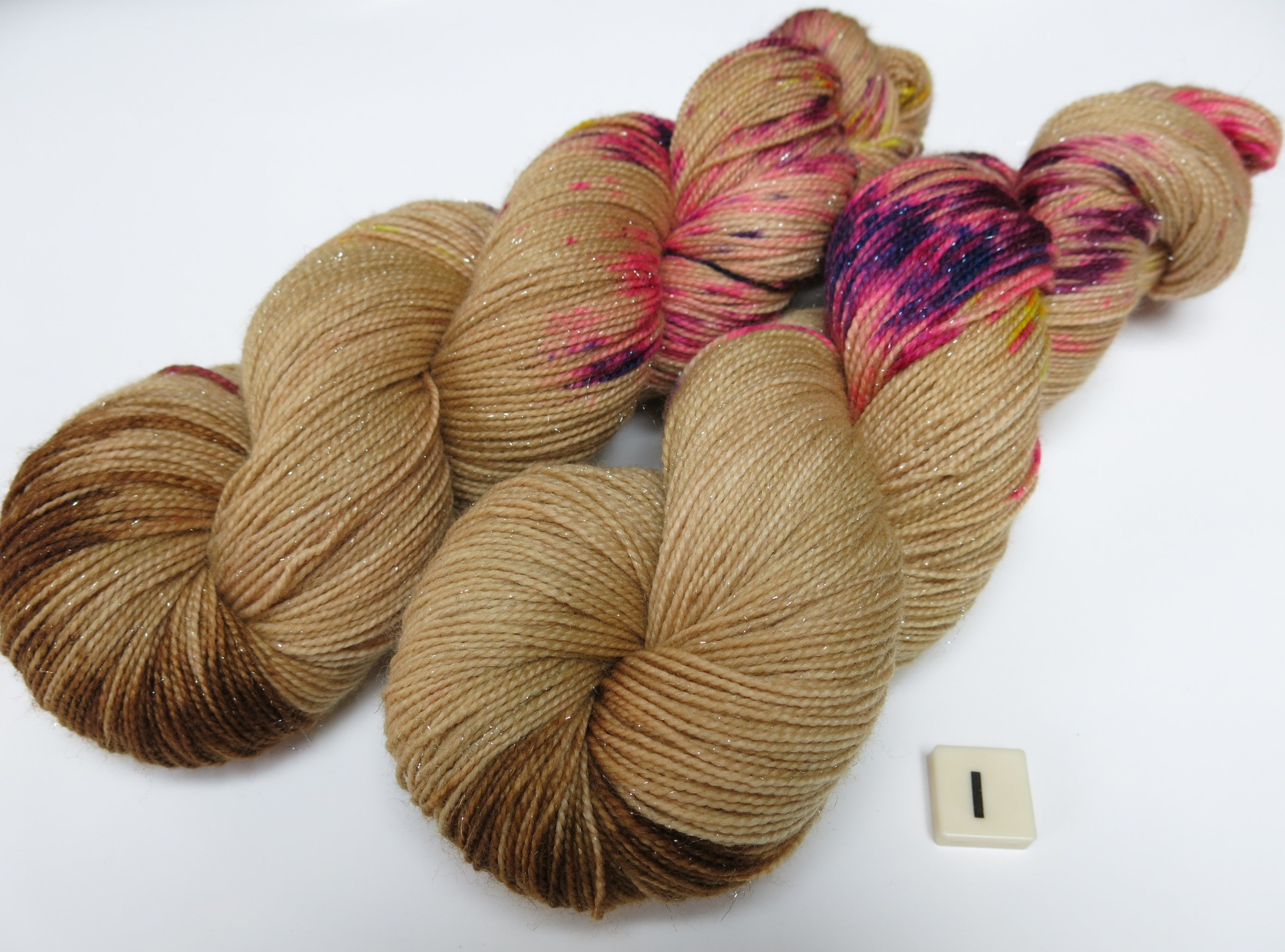 hand dyed speckled uv reactive yarn for socks and shawls