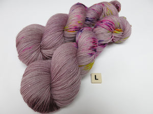 hand dyed uv reactive merino and nylon sock yarn skeins
