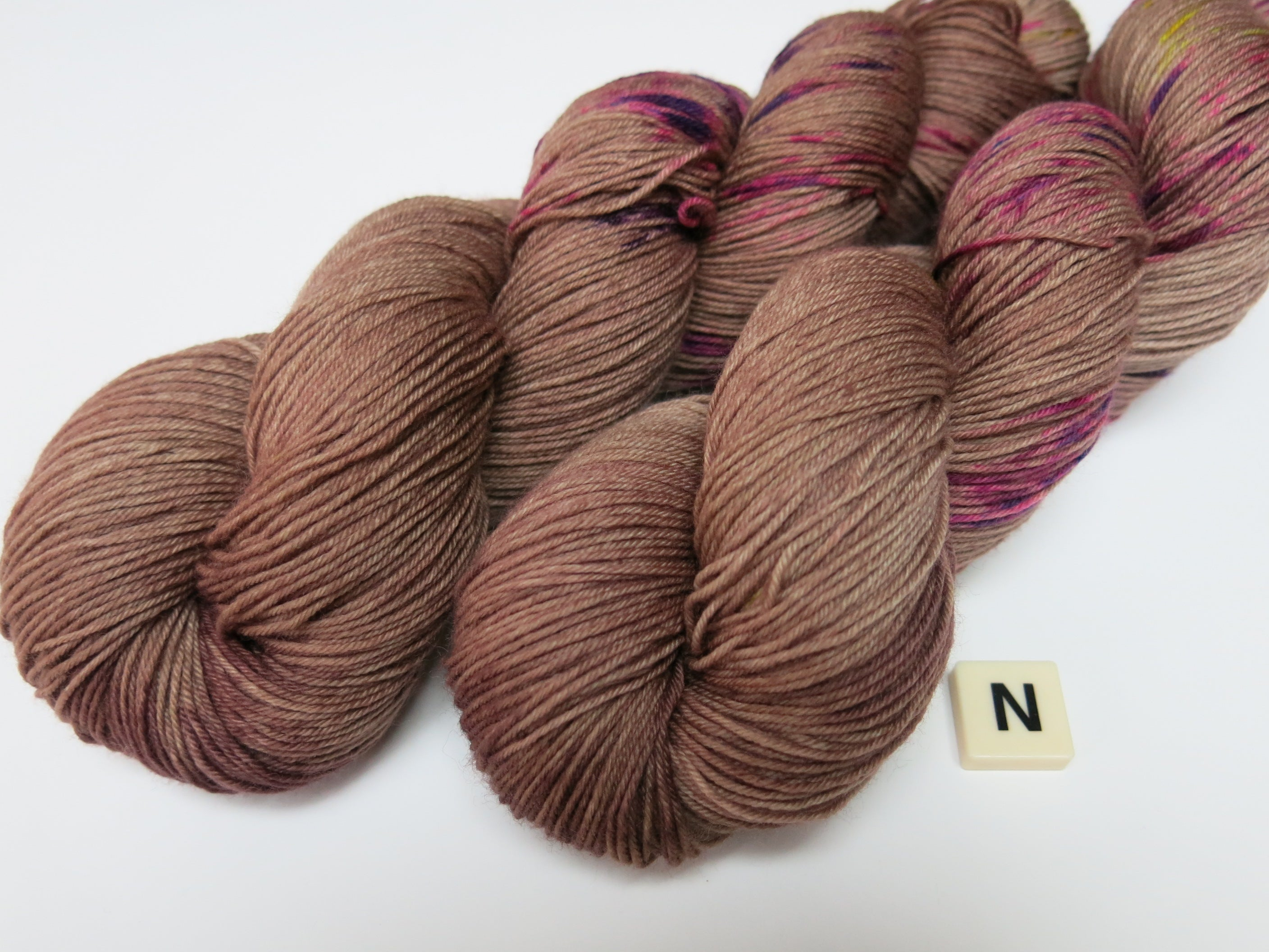 hand dyed brown sock yarn with neon speckles