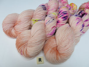 hand dyed uv reactive speckled merino yarn skeins