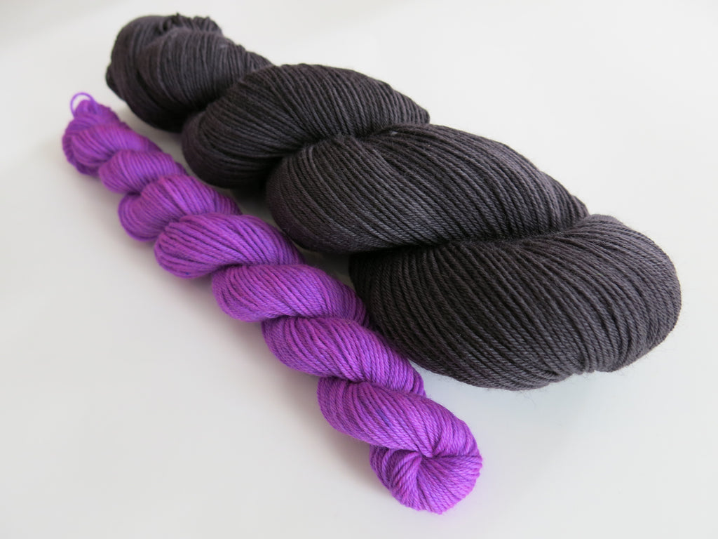 hand dyed sock yarn set with black and uv responsive purple