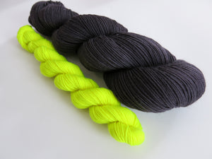 hand dyed sock yarn set with black and yellow mini skeins