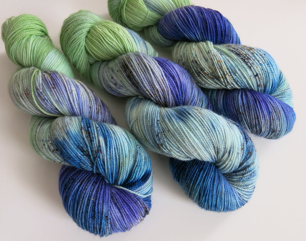 indie dyed blue green and purple bfl sock yarn skeins