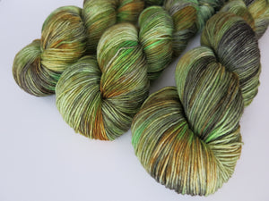 kettle dyed green and brown sock yarn skeins for knitting and crochet