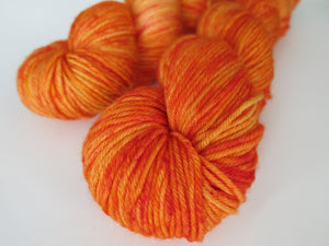 orange superwash merino and nylon dk yarn skeins