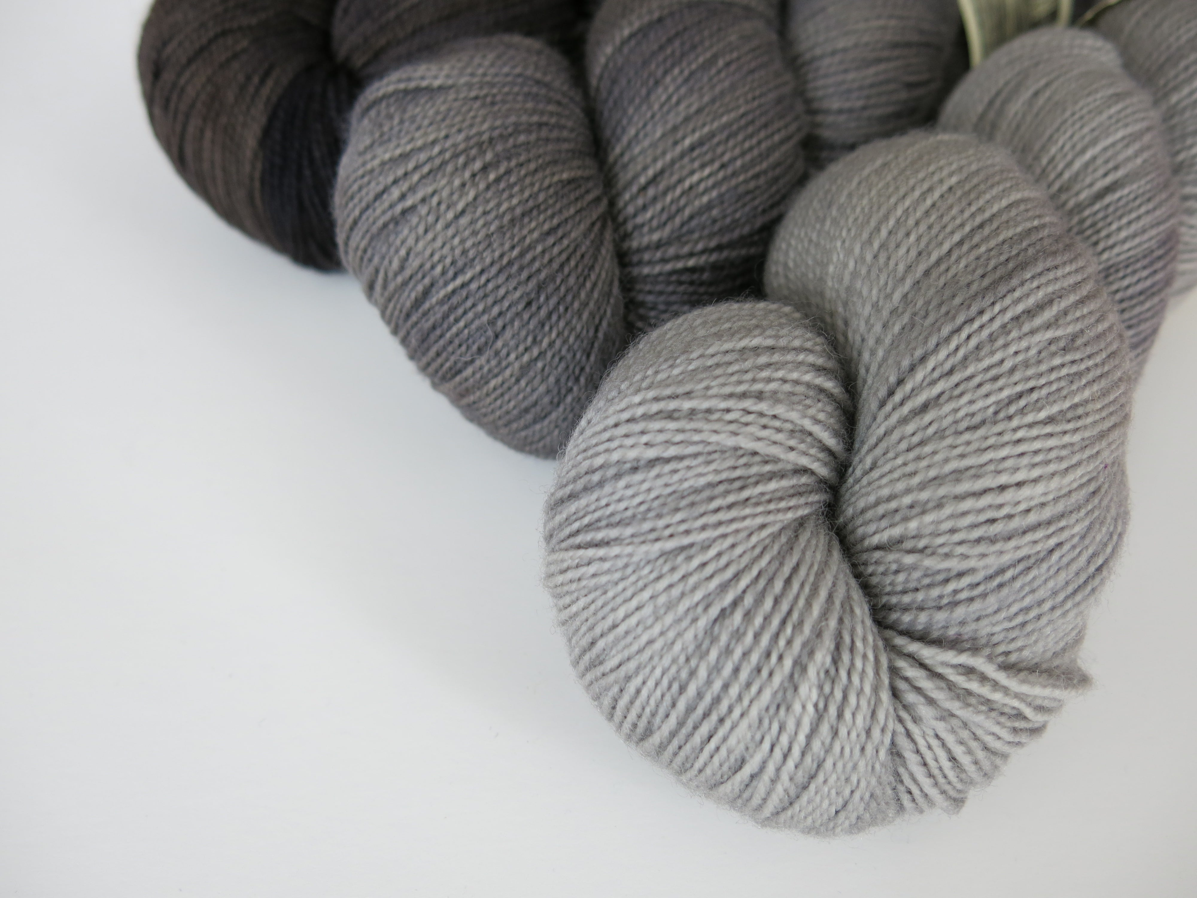 kettle dyed high twist british sock yarn set with grey and black