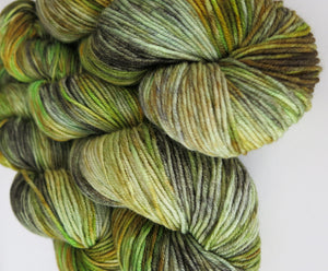indie dyed yarn in green and brown for knitting and crochet