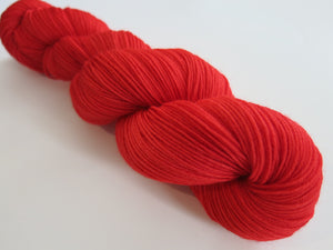 solid red merino sock yarn skein for knitting and crochet