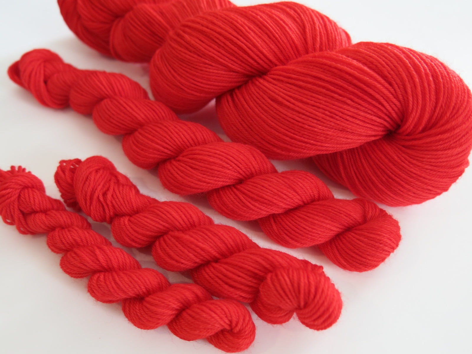 indie dyed red merino yarn skein by my mama knits
